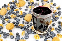 Juice of the dark blue purple berry enjoys the beautiful company of fresh organic whole berries and walnut pieces.