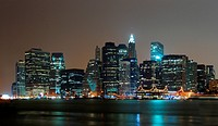 New York City Manhattan night scene panorama with city skyline over Hudson River.