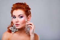 Close_up of a young, beautiful, red_haired woman.