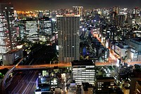 Tokyo streets, tracks and skyscrapers at night from high above