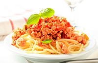 Minced meat sauce served on a bed of cooked spaghetti