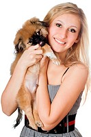 Portrait of young smiling woman with a puppy. Isolated on white
