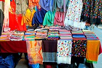 Colourful oriental style clothing at street stall