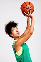 Beautiful athletic woman with basketball. Studio shot.