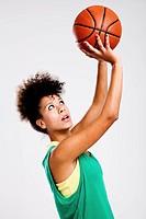 Beautiful athletic woman with basketball. Studio shot.
