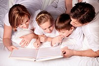 Parents of children reading a book
