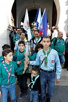 Muslim scouts coming out of the Paris Great Mosque carrying a torch, Paris, France, Europe