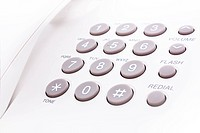 close up shot of grey and white phone keypad