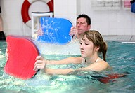 Patients doing aqua aerobics, water aerobics, exercise therapy, physiotherapy in water, e.g. as a rehabilitation program, in a hospital in Germany, Eu...