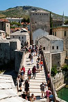 Tourists on Stari Most Old Bridge, UNESCO World Heritage Site, Mostar, municipality of Mostar, Bosnia and Herzegovina, Europe