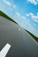 Asphalt road. A transport highway with the blue sky. A transport highway with the blue sky