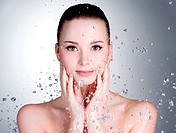 Portrait of beautiful young woman with drops of water around her face _ horizontal