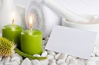 Spa set with candles and blank paper card with copyspace