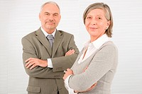 Professional elegant smiling senior businesspeople standing with cross arms