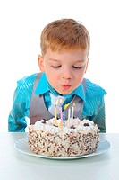 Beautiful little boy celebrates birthday. Isolated on white background
