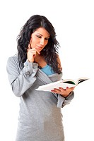 Portrait of Beautiful young woman reading the book on white background