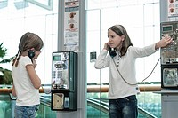 Children using payphones