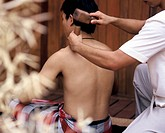 Toc sen, a form of traditional massage with a wooden mallet practiced in northern Thailand ...