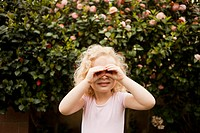 Cute blonde girl 4_5 looking through imaginary binoculars