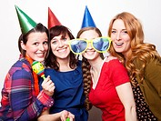 Studio Shot of young women dressed in party hat