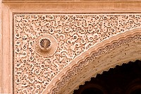 arabic sculpted archway detail in morocco, ben youssef medersa, marrakesh