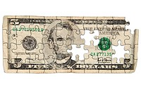 Worn Five dollar bill cut out into puzzle shapes isolated over white