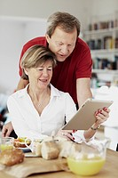 Mature couple using digital tablet