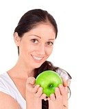 Young attractive woman with green apple isolated on white