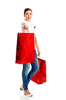 Beautiful young woman with red shopping bags. Consumerism Concept