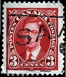 A stamp printed in Canada shows King George VI, circa 1949