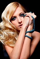 glamour portrait of beautiful curly blonde girl on dark