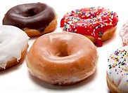 A group of fresh decorated donuts on a white background