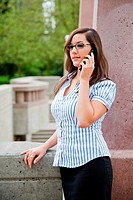 A shot of a beautiful caucasian businesswoman talking on the phone