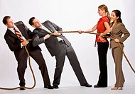 Business people playing tug_of_war