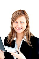 Confident businesswoman holding a laptop smiling at the camera against white background