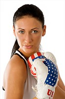 portrait of young beautiful brunette with usa flag boxing gloves