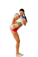 pretty brunette with boxing usa gloves giving a kick