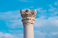 Greek column on the blue sky background
