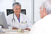 Portrait of smiling female doctor and patient.