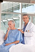 caring doctor performing medical check_up on patient