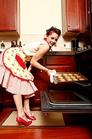 Young woman baking cookies in the kitchen.