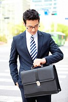 Asian Businessman Looking At Time