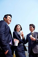 Business People Holding Takeaway Coffee