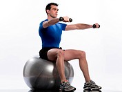 man exercising workout on white background.Seated Swiss BallLateral Arm Raise