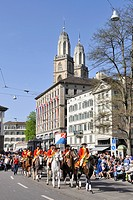 Reitclub St. Niklaus Zurich riding club at the traditional Sechselaeuten parade in the historic district of Zurich, the two steeples of Grossmuenster ...