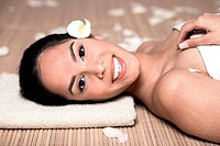 Photo of bautiful smiling woman lying down for spa treatment