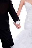 Bride and groom hands holded together over white background
