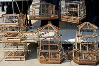 Bird cages for sale in an outdoor market