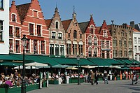 Restaurant terraces on the market square of Bruges, Flanders, Belgium, Europe