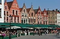 Restaurant terraces on the market square of Bruges, Flanders, Belgium, Europe